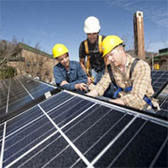 Sustainable Technology students working on solar panel installation