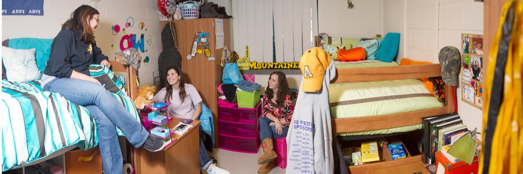 Students in ASU dorm room